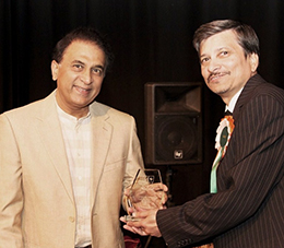 Dr Kishore Tiwary receiving award