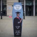 Amin coffin outside DoH